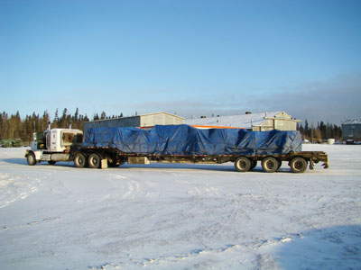 Tarped load of steel rims for big ore trucks in Fort McMurray Alberta
