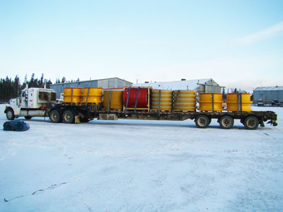 Load of steel rims for big ore trucks in Fort McMurray Alberta